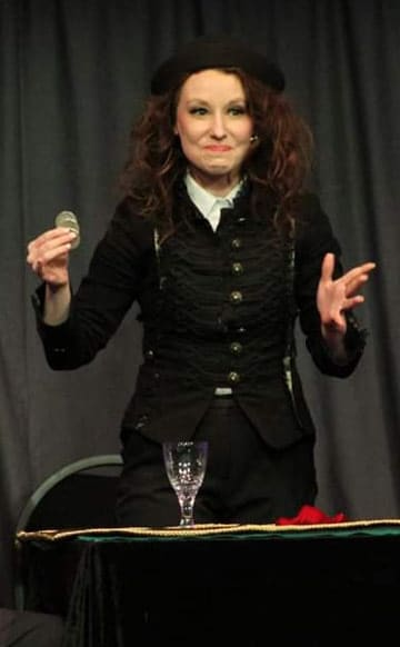 A female conjurer are demonstrating her skill